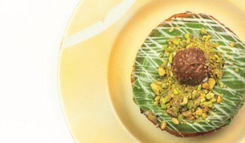 Pistachio Glazed Ciambella with Ferrero Rocher - Take Stock Magazine