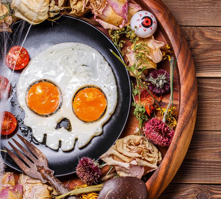 Fried eggs in the shape of a cartoon skull