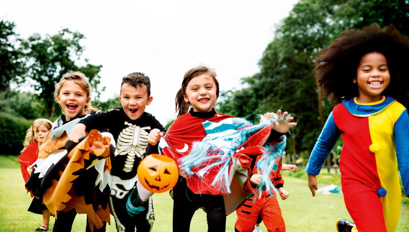 Kids running in costumes