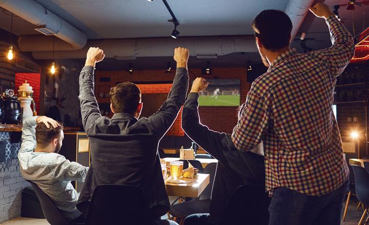 People cheering at football on TV