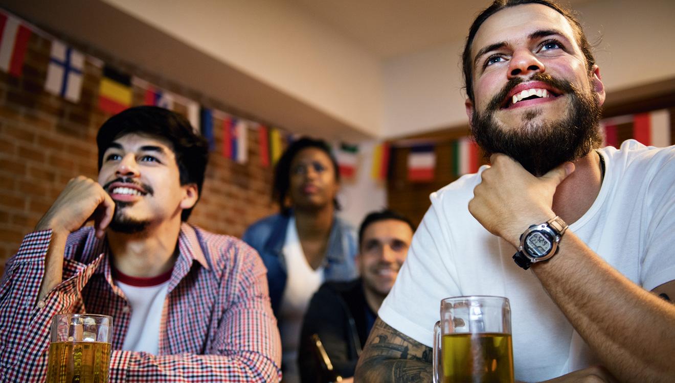 People watching football game