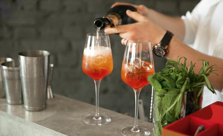 Bartender making a fizz cocktail